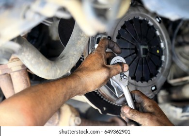 Cars clutch, Automotive mechanic tightening using a torque wrench, fixed problem the clutch of the car.