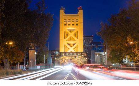Cars come and go from the Tower Bridge at night in Sacramento