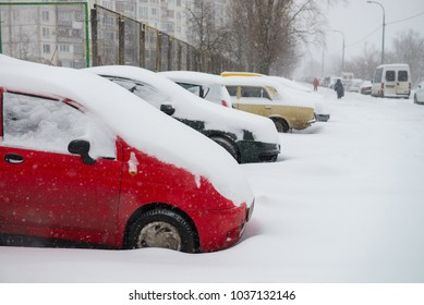 Cars covered in snow ukrainian winter