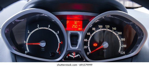 Car's dashboard while the engine is running.