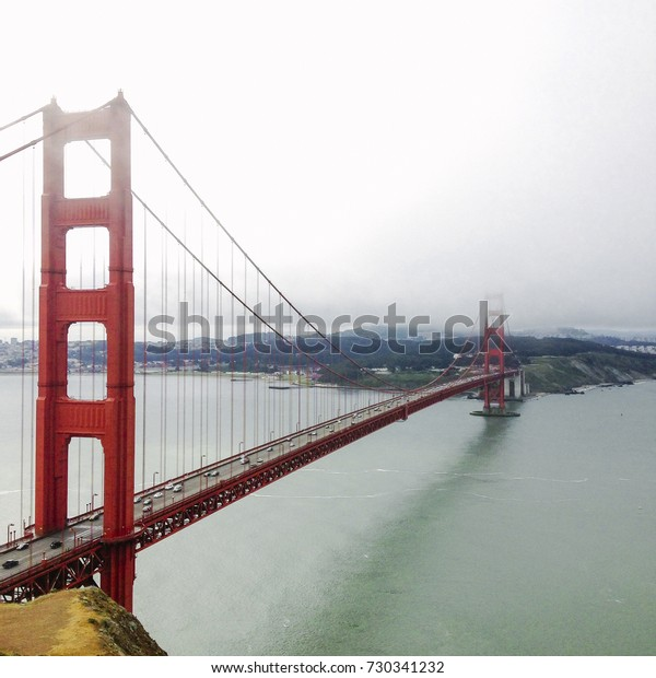 Cars drive across the San Francisco Bay Bridge from Marin County towards the city.