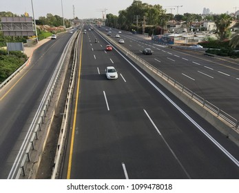 Cars drive along the highway in Israel from above. Israel, Netanya, May 2018