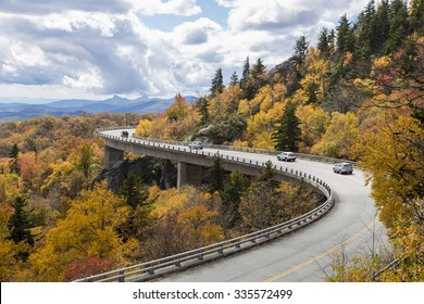 Cars drive over Linn Cove Viaduct, Blue Ridge Parkway in the Fall, NC
