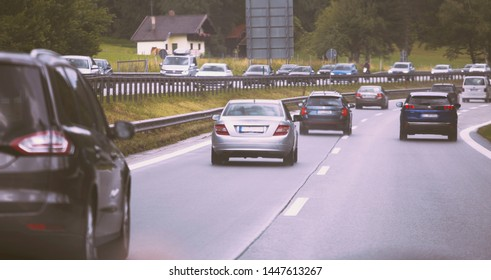 Cars driving on highway in traffic jam