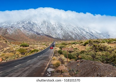 Cars driving on road in Teide National Park Tenerife