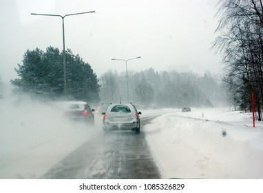 Cars driving on slippery road