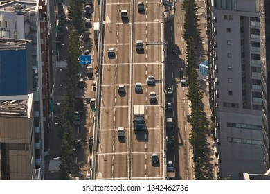 Cars driving on an urban expressway in Japan