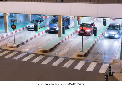 Cars exiting a parking garage at the airport.