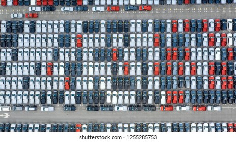 Cars export terminal in export and import business and logistics. Shipping cargo to harbor. Water transport International. Aerial view and top view.