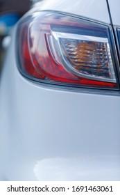Car's exterior details.Element of design.Rear light. Rear light of a modern white car.