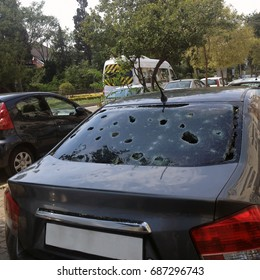 car's glass is broken from hail