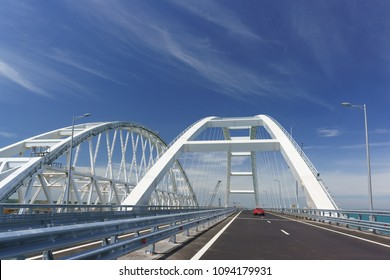 Cars go on the Crimean automobile bridge connecting the banks of the Kerch Strait: Taman and Kerch
