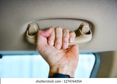 Car`s grab handle,Holding plastic car grab handler for the passenger.