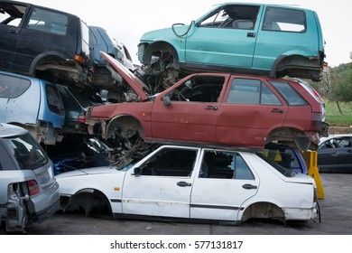 Cars in junkyard,  pile for recycling.