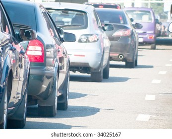 Cars line up against a detour caused by a fatal accident on the highway during rush hour