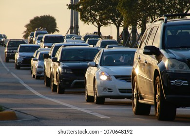 Cars Lined Up in Bumper-to-Bumper Rush-Hour Traffic Heading East on Sample Road Next to Turnpike in Pompano Beach, Florida at Sunset