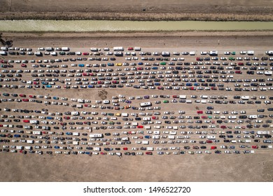 cars lined up to enter a festival