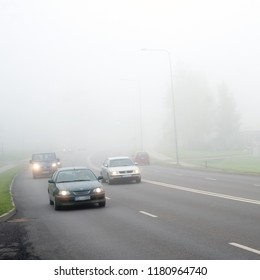 Cars in the mist