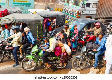 Cars and motorcycles in India. Traffic in the city. Crowd on the road. India, Govardhan, November 2016