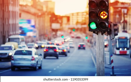 Cars moving on the road in city in late evening. View to the traffic with trafficlights and transport