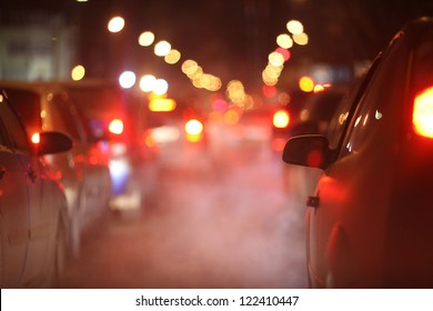 cars at night in a traffic jam in winter frost
