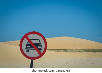 Cars not allowed sign on beach sand