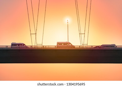 Cars on Bosphorus Bridge known officially as the 15 July Martyrs Bridge is one of the three suspension bridges spanning the Bosphorus strait in Istanbul, Turkey. Sunset sky in background.