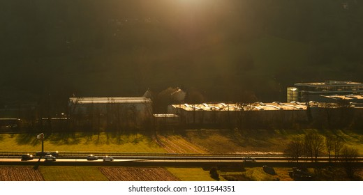 Cars on a federal highway in warm light and backlight of the sun