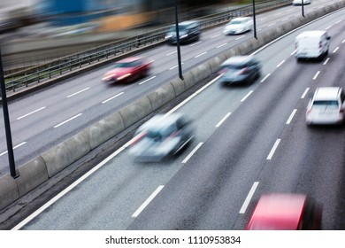 cars on the freeway at high speed