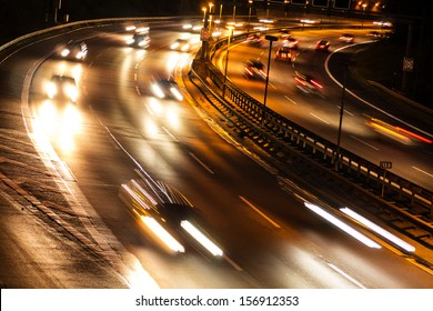 cars on highway by night