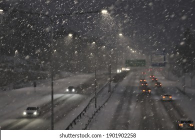Cars on the highway in heavy snow at night