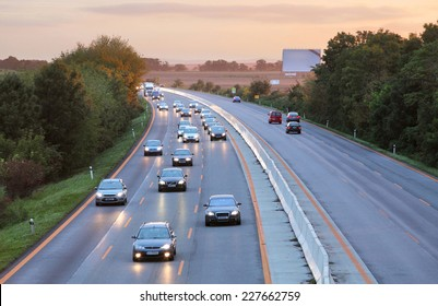 Cars on highway road at sunset