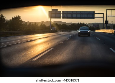 Cars on a highway at sunset (shallow DOF; color toned image)