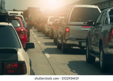 ฺBlurred of cars on the road heading towards the goal of the trip. During the daytime rush traffic. There is a level bridge on the side.
