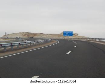Cars on the road. Mangistau region. Kazakhstan.