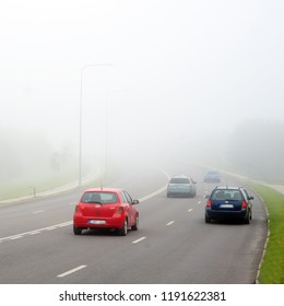Cars on the road in mist