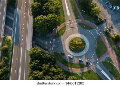 Cars on roundabout and intersecting roads
