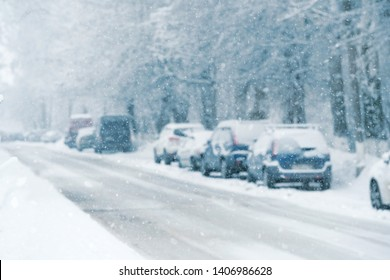cars on snow road. blurred abstract winter background, snow and transport. seasonal auto concept. winter background cityscape. bad weather, blizzard. copy space