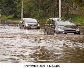 Cars on the street flooded with rain