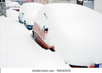 Cars on street in snow storm