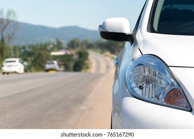 Cars on the street travel mountainous background