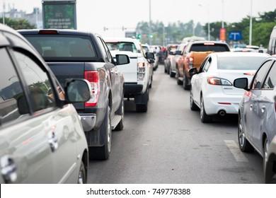 Cars on urban street in traffic jam