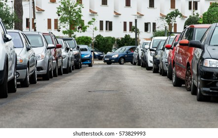 Cars parked along the street.