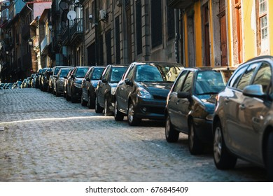 Cars parked along the streets of the old town.