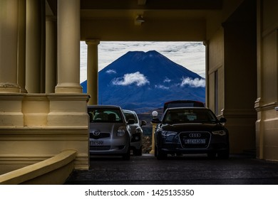 Cars parked in front of Chateau Tongariro with Volcanic Mount Ruapehu framed in background in Tongariro National Park, New Zealand on 29 February 2012