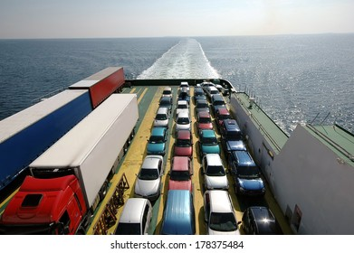 Cars parked on a ferry.