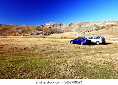 cars parked on a meadow in the Mavrovo Region in Macedonia