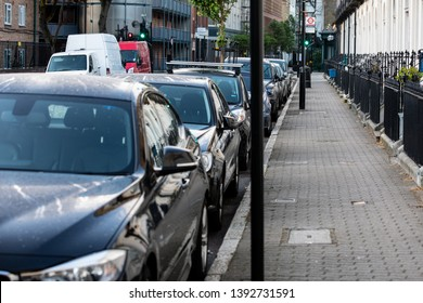 Cars parked on the street. City of London, United Kingdom