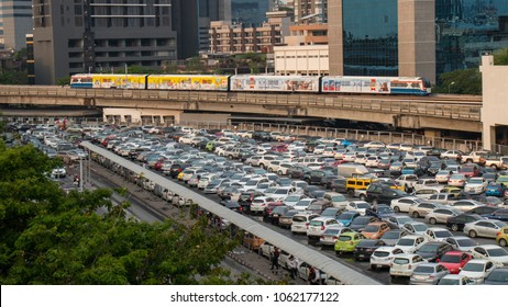 A lot of cars parked at a park at BTS Skytrain Mo-Chit station in Chatuchak district in Bangkok, Thailand - 1 APR 2018.