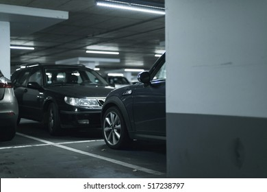 Cars parked in parking garage.